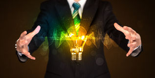 Businessman holding light bulb Royalty Free Stock Image