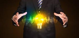Businessman holding light bulb Royalty Free Stock Photography