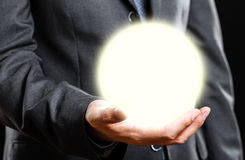 Businessman holding a light sphere Royalty Free Stock Photo