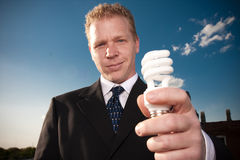 Businessman holding lightbulb Royalty Free Stock Photography