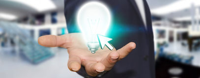 Businessman holding lightbulb Royalty Free Stock Photography