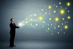 Businessman holding lightbulbs Royalty Free Stock Images
