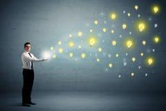 Businessman holding lightbulbs Royalty Free Stock Photos