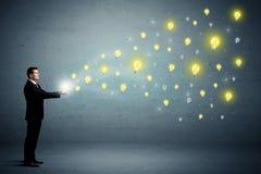 Businessman holding lightbulbs Stock Images