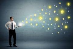 Businessman holding lightbulbs Stock Image