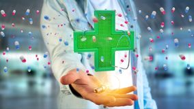 Businessman holding a Lighting pharmacy cross and a stethoscope. View of a Businessman holding a Lighting pharmacy cross and a stethoscope - 3d render Royalty Free Stock Image