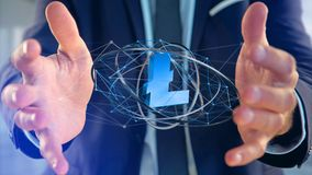 Businessman holding a litecoin crypto currency sign flying aroun. View of a Businessman holding a litecoin crypto currency sign flying around a network Royalty Free Stock Images