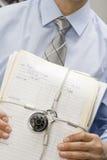 Businessman Holding Locked File Folders royalty free stock image
