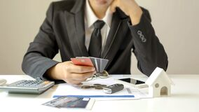 Businessman holding a lot of credit cards and stressful gesture from debts finance concept