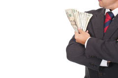 Businessman holding a lot of dollar bills Royalty Free Stock Image