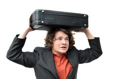 Businessman holding luggage above head Stock Images