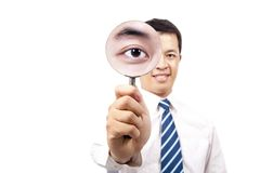 Businessman holding Magnifier Stock Image