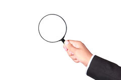Businessman holding magnifying glass Royalty Free Stock Image