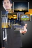 Businessman holding many image button. Royalty Free Stock Image
