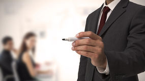 Businessman holding a marker Stock Images