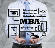 Businessman holding mba concept Royalty Free Stock Image