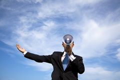 Businessman holding megaphone. And cloud background Royalty Free Stock Photo