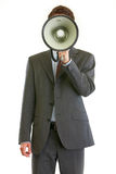 Businessman holding megaphone in front of face royalty free stock photos