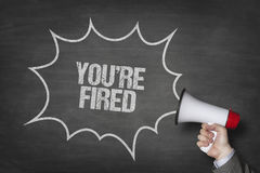 Businessman Holding Megaphone By Youre Fired Text On Blackboard Royalty Free Stock Photos