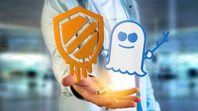 Businessman holding a Meltdown and Spectre processor attack with. View of a Businessman holding a Meltdown and Spectre processor attack with network connection Stock Photo