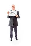 Businessman holding a message board with the text words Help wa Royalty Free Stock Images