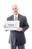 Businessman holding a message board with the text words Vote Royalty Free Stock Photos
