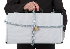 Businessman holding metal suitcase Royalty Free Stock Photography