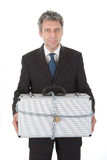 Businessman holding metal suitcase Stock Photography