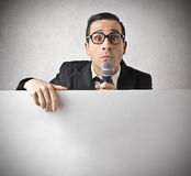 Businessman holding a microphone stock images