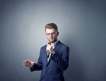 Businessman holding microphone Stock Photo