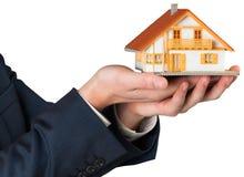 Businessman holding miniature house model Royalty Free Stock Photos