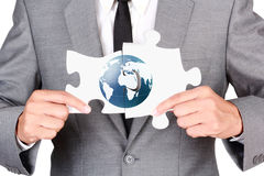 Businessman holding mismatch jigsaw. Businessman holding blank jigsaw  on white background with clipping path Royalty Free Stock Images