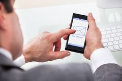 Businessman Holding Mobile With New Message On A Screen stock images