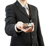 Businessman holding mobile phone Stock Image