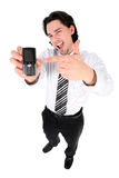 Businessman holding mobile phone Royalty Free Stock Image