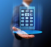 Businessman holding mobile phone Royalty Free Stock Images