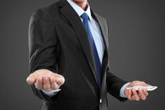 Businessman holding mobile smart phone, another hand presenting Royalty Free Stock Image