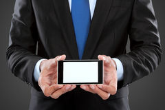 Businessman holding mobile smart phone with blank screen. Isolated on white Stock Photo