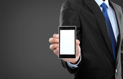 Businessman holding mobile smart phone with blank screen Royalty Free Stock Photography