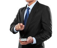 Businessman holding mobile smart phone and touching screen Stock Photos