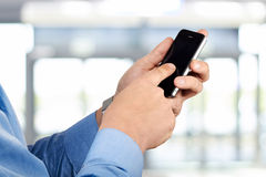 Businessman holding  the  mobile  smart  phone Stock Image