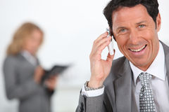 Businessman holding mobile telephone Royalty Free Stock Images