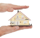 Businessman holding model of a house in hands Royalty Free Stock Photo