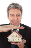 Businessman holding model of a house in hands Royalty Free Stock Images