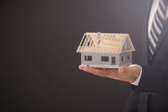 Businessman Holding Model House Royalty Free Stock Photography