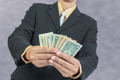 Businessman holding Money Cash Dollars in hands Royalty Free Stock Photo