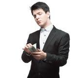 Businessman holding money Royalty Free Stock Image