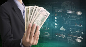 Businessman holding money celebrates success on investment. Royalty Free Stock Image