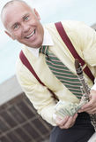 Businessman holding money and a flute Royalty Free Stock Photography