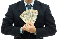 Businessman holding money Stock Photo